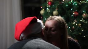 Man giving a christmas present to his girlfriend stock footage