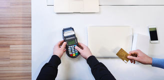 Man giving credit card to shop Stock Photography