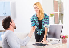 Man giving credit card to woman Stock Images