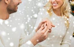 Man giving diamond ring to woman for christmas royalty free stock image