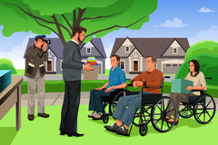 Man Giving Donation to the Disable People in an Event Royalty Free Stock Photo