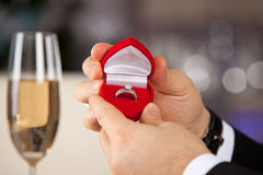 Man giving engagement box with ring. Will you marry me royalty free stock image