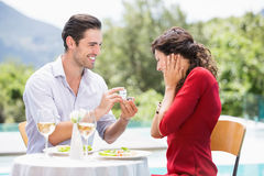 Man giving engagement ring to astonished woman Royalty Free Stock Photo