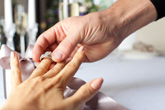 Man giving engagement ring to his girlfriend. Marry me royalty free stock photos