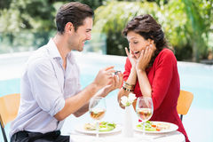 Man giving engagement ring to surprised woman Stock Images