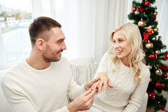 Man giving engagement ring to woman for christmas Royalty Free Stock Photography