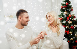 Man giving engagement ring to woman for christmas Royalty Free Stock Photo