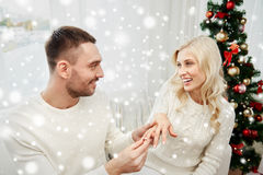 Man giving engagement ring to woman for christmas Stock Image