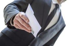 Man giving envelope Royalty Free Stock Photo