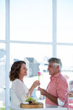 Man giving flower to happy woman Royalty Free Stock Images