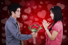 Man giving flower to his girlfriend Stock Photo
