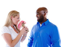 Man giving Flowers. A man gives flowers to a woman stock image