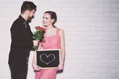 Man giving flowers to his girlfriend royalty free stock image