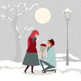 A man giving flowers to his lover on a winter day. Royalty Free Stock Photos