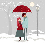 A man giving flowers to his lover on a winter day. Stock Image