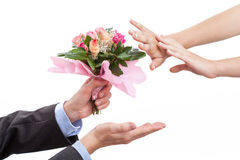 Man giving flowers to his wife after argument stock photos