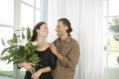 Man giving flowers to woman. Stock Image