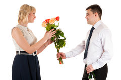 Man giving flowers to woman on March 8 Stock Photo