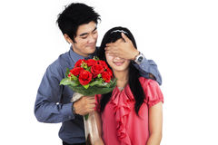 A man giving flowers to woman. A men giving flowers to his wife - isolated on white background Royalty Free Stock Photo