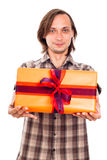 Man giving gift Stock Images