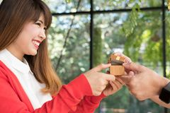 Man giving gift box with engagement ring to woman. boyfriend mak Royalty Free Stock Photos