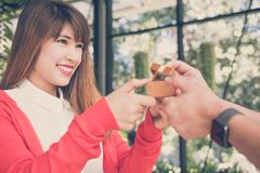 Man giving gift box with engagement ring to woman. boyfriend mak Stock Photography