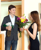 Man giving a gift box to his young wife Royalty Free Stock Photos