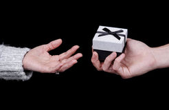 Man giving a gift box to a woman Stock Image