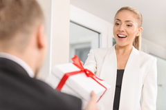 A man giving a gift Royalty Free Stock Images