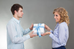 Man giving a gift to his girlfriend Royalty Free Stock Photography