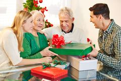 Man giving gift to his mother at christmas Royalty Free Stock Photography