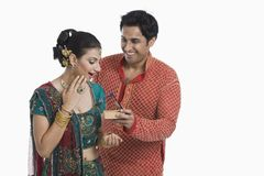 Man giving gift to his wife on Diwali. And smiling