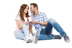 Man giving a gift to his woman Stock Photos
