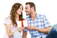 Man giving a gift to his woman Royalty Free Stock Image