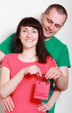 Man giving a gift to surprised smiling woman Stock Photos