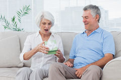 Man giving a gift to wife Royalty Free Stock Photos