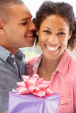 Man giving gift to woman Royalty Free Stock Photos