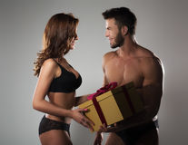 Man giving gift to woman. Beautiful young couple Stock Image