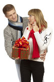 Man giving a gift to woman Royalty Free Stock Photo