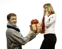 Man giving a gift to woman Royalty Free Stock Images