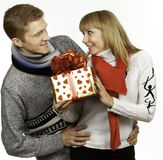 Man giving a gift to woman Stock Photo