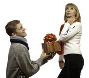 Man giving a gift to young woman Stock Images