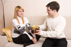 Man is giving gifts woman at Valentine?s day. Royalty Free Stock Image