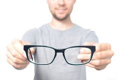 Man giving a glasses. Isolated on white Stock Image