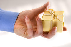 Man Giving a Gold Gift Royalty Free Stock Images