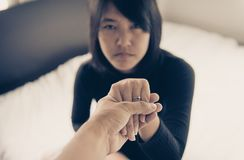 Man giving hand to depressed woman,Psychiatrist holding hands patient,Mental health care concept. Man giving hands to depressed woman,Psychiatrist holding hands stock image