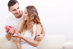 Man giving heart-shaped box for his girlfriend stock images