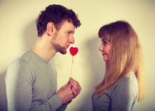 Man giving heart to his girl. Romance symbolism valentines concept. Man giving heart to his girl. Young male proffesing love to woman, by giving her heart Stock Photos