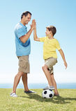 Man giving high five to his little son Royalty Free Stock Photo