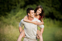 A man giving his girlfriend a piggyback Stock Image